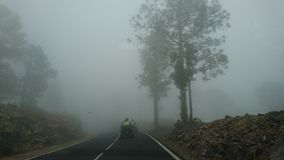 Atv on foggy road at teide Stock Photography