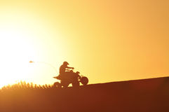 ATV in the Golden light. ATV in Glamis sand Dunes during sunset Royalty Free Stock Photos