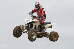 ATV Motocross Rider Over a jump Royalty Free Stock Image