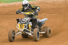 ATV Motocross Rider powering out of corner Royalty Free Stock Photos