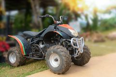 ATV motorcycle for rentals service at the resort with mountain n Royalty Free Stock Photos