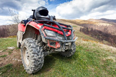 ATV on mountains landscape Royalty Free Stock Image