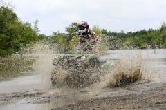 ATV in mudhole Stock Afbeeldingen