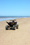 ATV na praia Imagens de Stock
