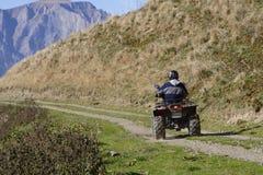 ATV nelle montagne Fotografia Stock