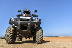 ATV offroad on sea and sky background Royalty Free Stock Image