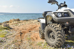 ATV offroad on sea and sky background Stock Images