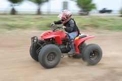 Atv or quad bike racing. Panning of atv or quad bike racing Stock Image
