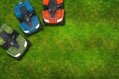 ATV Quad Bikes on Grass Stock Photography