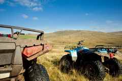 ATV quad bikes on Snowdonia mountain. Off road quad bikes on mountainside in remote Welsh valley royalty free stock photography