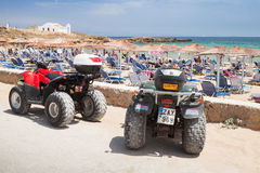 ATV quad bikes stand parked near beach Stock Photo