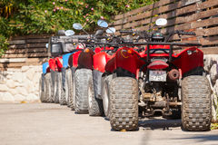 ATV quad bikes stand parked in a row Stock Photos