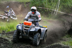 ATV Quad Extreme Race. Two quads competing during race on muddy track stock image
