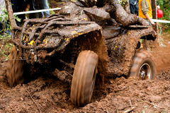 ATV race in the mud. ATV enduro race with rider in the mud Stock Images