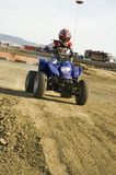 ATV racer on dirt track Stock Photos