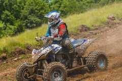 ATV racer in the mud Royalty Free Stock Photos