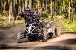 ATV racer takes a turn during Stock Photography