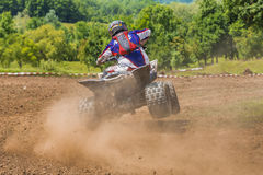 ATV racer takes a turn Royalty Free Stock Photo