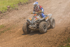 ATV racer. Racer on ATV vehicle driving in the mud on June 20, 2015 in Moreni, Romania Royalty Free Stock Image