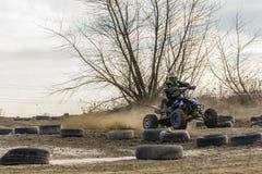 ATV-Reiter im Rennen Stockbilder