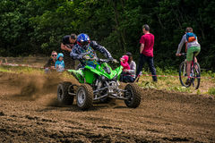 ATV Rider accelerating in dirt track. Royalty Free Stock Photography