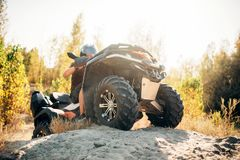 Atv rider climbing the sand mountain in quarry stock images