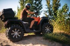 Atv rider climbing the sand mountain in quarry royalty free stock photos