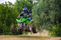 ATV Rider in Dirt Bike Jumping action. TransCarpathian regional Motocross Championship stock photography