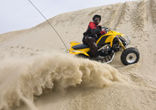ATV rider spraying sand Royalty Free Stock Photography