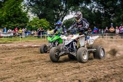 ATV Rider on start in the action. Stock Photos