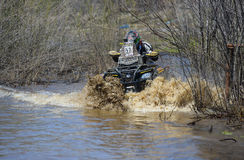 ATV rides through the mud with a big splash Royalty Free Stock Photography