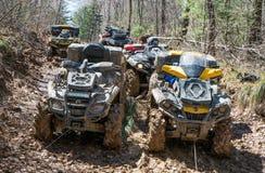 ATV rides through the mud with a big splash Stock Photos
