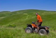 Atv riding on hills - quad Royalty Free Stock Photography
