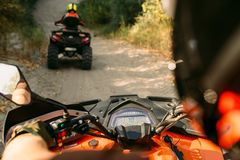 Atv riding, view through the eyes of driver royalty free stock images
