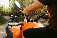 Atv riding, view through the eyes of driver stock photography