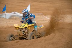 ATV scatters sand and dirt. SERPUKHOV, RUSSIA - OCTOBER 7, 2017: Dan`kov Vladimir 42,  Class ATV, in the 4 stage  MX series, the Red Wings Cup 2017 super country Stock Photos