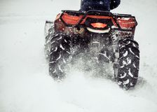 ATV slips in the snow. Cleaning the streets of snow with a tractor stock photography