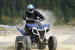 ATV splash. ATV racer driving through a pit filled with water Stock Photography