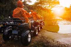 Atv sport vehicle team ready to adventure in mud track Stock Images