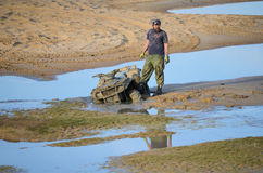 ATV Stuck Mud Pit Pond Man Royalty Free Stock Photos
