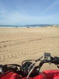 ATV sulla spiaggia Fotografia Stock