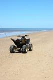 ATV sulla spiaggia Immagini Stock