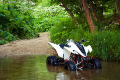ATV in water Stock Photography