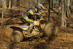 ATV woods racer. Image of ATV's racing in the woods on a closed course Stock Photography