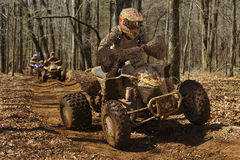 ATV woods racing 2. Image of ATV's racing in the woods on a closed course royalty free stock photography