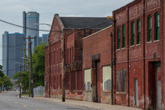 Atwater Street. Detroit, MI, USA – Sept 18, 2015.  Boarded up brick industrial buildings along Atwater Street in Detroit.  General Motors headquarters at the Stock Photo