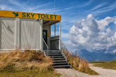 Atypical toilet on top of a mountain Royalty Free Stock Image
