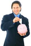 Außer Geld auf Piggy Querneigung stockfotos