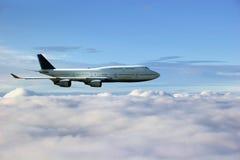 au-dessus des nuages d'avion Images stock