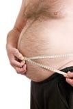 Au-dessus du mâle de poids avec la bande de mesure Photos stock